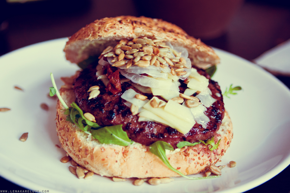 tasty burger with cheese and seeds in Timesburg hamburgueseria,Barcelona center